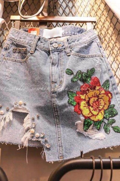 Floral Beaded Embroidered Denim Mini Skirt Featuring Heavily Distressed Detailing and Beaded Embellishment